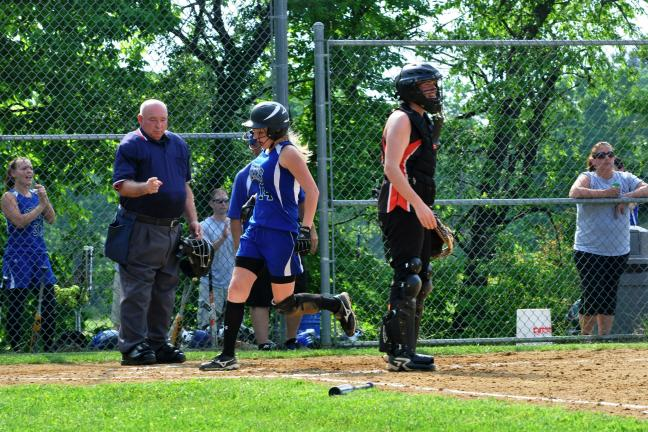 MIKE FEIFEL/TIMES NEWS Tracy Deubler crosses the plate to score Pleasant Valley's lone run in a 2-1 loss to Northampton as umpire Andy Harvan looks on.