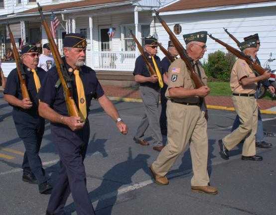 ANDREW LEIBENGUTH/TIMES NEWS New Philadelphia's Memorial Day on Monday parade drew the attention of many as it marched down Valley Street (SR209) and then through town, ending at the town court. Some groups marching consisted of the New Philadelphia…