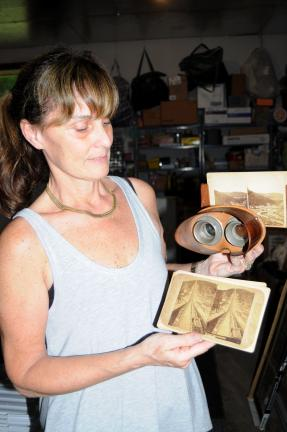 Ron Gower/TIMES NEWS Nancy Albeck of Jim Thorpe holds stereo viewer and accompanying photos of the Switchback Railroad which are part of the Mauch Chunk collection of her late father, Bill Huber. The vast collection will be solde during an auction…