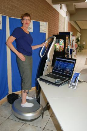 Gail Maholick/TIMES NEWS Jeanine D'Andrea, owner of a Good Vybrations whole body vibration machine at a kiosk at the Carbon Plaza Mall said 10 minutes on the Sonix Whole Body vibration machine helps people lose weight and a heightened feeling of wellness.