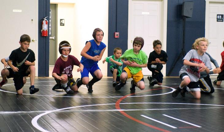 bob ford/times news Youngsters run through drills during the opening night of a summer long wrestling clinic being held at the Pyramid Sports Performance Center in Lehighton. The sessions are open to wrestlers competing in booster club through high…