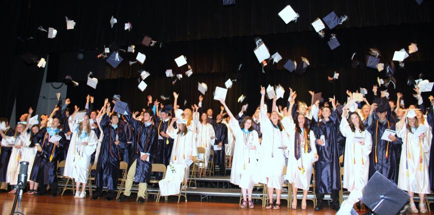 ANDREW LEIBENGUTH/TIMES NEWS Tamaqua seniors launch their graduation caps in celebration at last night's commencent.