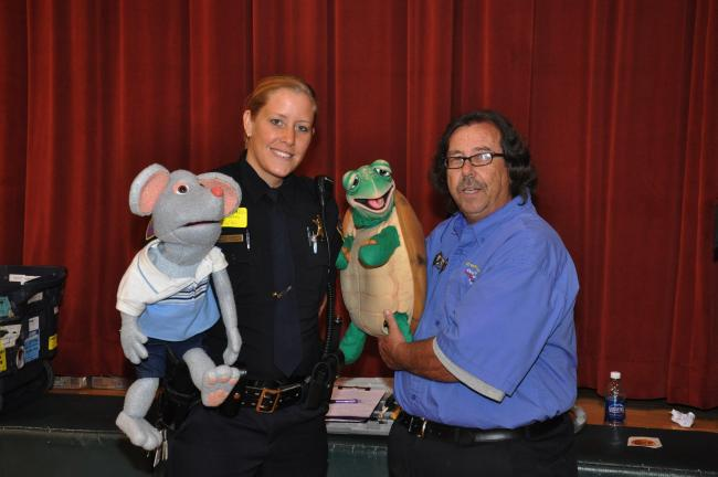 AMY MILLER/TIMES NEWS Carbon County Deputy Sheriff Kristy Cummins, left, and Mike McDade, hold two of the guests of the Deputy Phil show, Mac the Mouse, held by Cummins; and Turbo Turtle, held by McDade.
