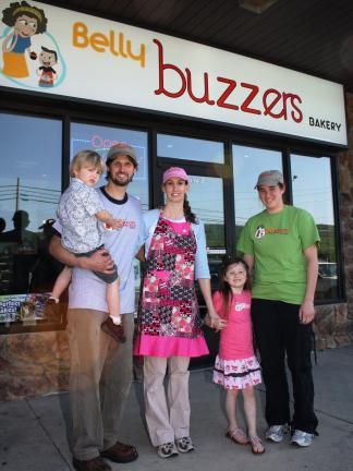 ANDREW LEIBENGUTH/TIMES NEWS Pictured outside their new bakery are co-owner Mike Scott holding son Keagan, 3; co-owner Tina Scott with daughter, Autumn, 5; and Cathy Cabana, pastry chef. Not pictured was Janet Scott.