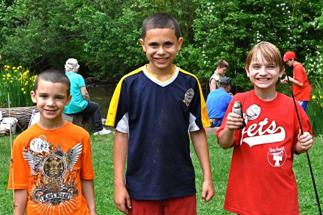 Six-year-old Francisco Morales, 9-year-old Anthony Roth, and 9-year-old Ronald Lighting II, all from Jim Thorpe, are all smiles at the 2nd Annual Jim Thorpe Police Fishing Contest which was held at the Germantown Grove.