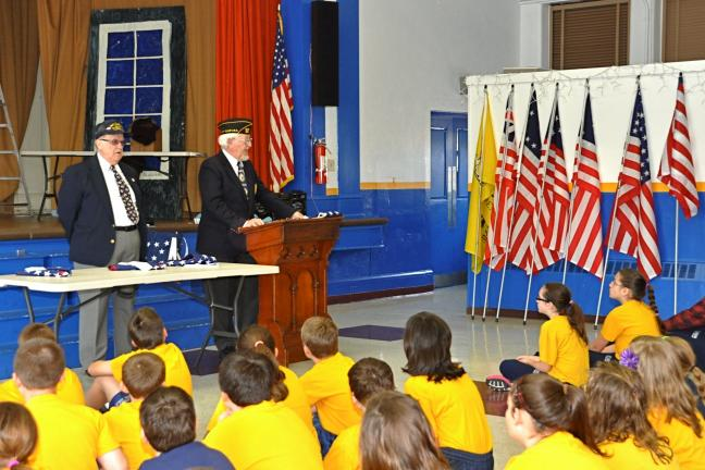 VICTOR IZZO/SPECIAL TO THE TIMES NEWS Navy Club of Carbon County members Stanley Jarlszewski (left) and Scott Reinhart visited Saint Joseph Regional Academy (SJRA) in Jim Thorpe to speak to the student body about the history of the American flag and…