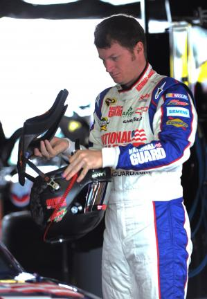 bob ford/times news Dale Earnhardt Jr. adjusts his helmet before going out for a practice run.