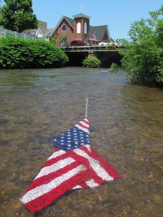 ANDREW LEIBENGUTH/TIMES NEWS A Tamaqua resident called police Sunday morning after noticing an American flag floating in the Little Schuylkill River.