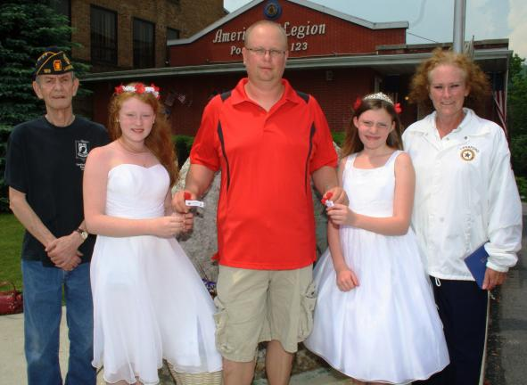 ANDREW LEIBENGUTH/TIMES NEWS From left are Jack Anderson, Commander, Lansford American Legion Post 123; Little Miss Poppy Koryn Van Horn, 12; Ron Hood, Lansford Mayor; Poppy Queen Ayana Batchelder, 13; and Mary Lou Check, President, Women's Auxiliary.