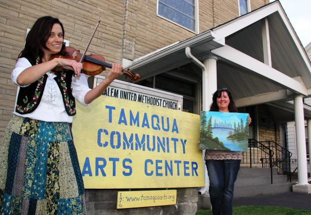 ANDREW LEIBENGUTH/TIMES NEWS Event organizers Rose Beck, left, and Kim Grant stand in front of the new Tamaqua Community Arts Center to promote Sunday's full day of music and art events.