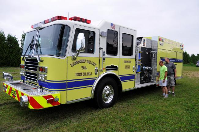 RON GOWER/TIMES NEWS Lieutenant Rick Frey, left, and Fire Chief Mark Ebbert, both of Mahoning Valley Fire Company, examine new 2013 KME pumper that the fire company purchased. The new piece of apparatus probably won't be placed in service until next…
