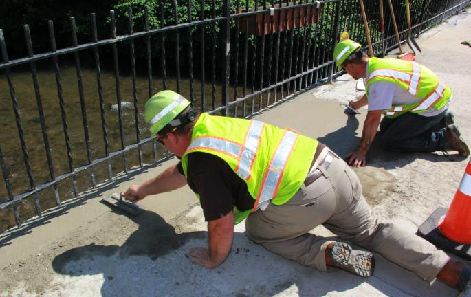 ANDREW LEIBENGUTH/TIMES NEWS A PennDOT bridge crew spent time repairing large holes and lose rails along the East Broad Street (SR209) bridge in Tamaqua. Even though this bridge, which runs over the Little Schuylkill River, is scheduled to go under…
