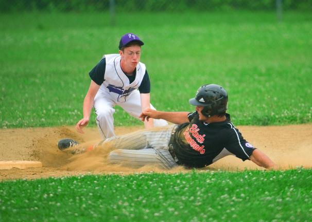 bob ford/times news Richard Smith of the Panther Valley Black Diamonds slides safely into second base as Matt Stillwell of the Franklin Township Shockers applies the tag.