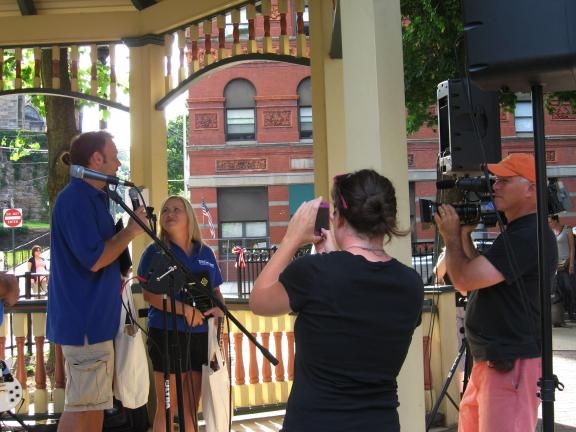 STACEY SOLT/SPECIAL TO THE TIMES NEWS ABOVE: Best of the Road 2012 Rally members Dusty and Nikki Green, left, speak to members of the Jim Thorpe community during their welcome to the town while being filmed by a video crew from the Travel Channel…