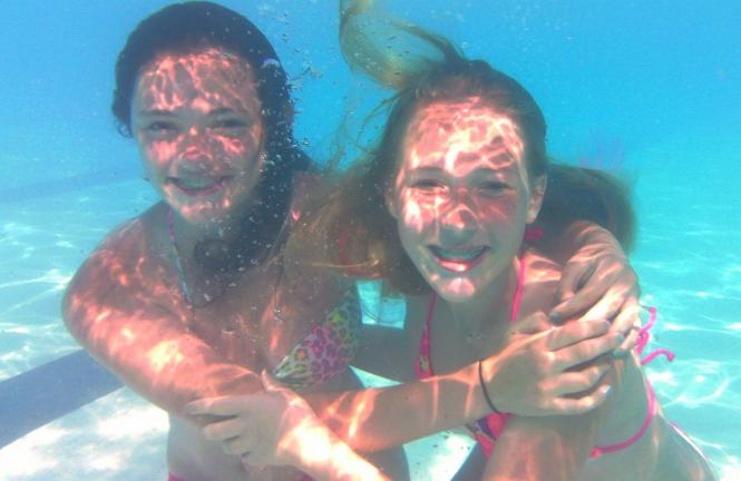 ANDREW LEIBENGUTH/TIMES NEWS Kelsey Ziegler, 12, left, and Merranda Zehner, 14, enjoy themselves as the TIMES NEWS photographer uses his underwater camera to snap their photo.