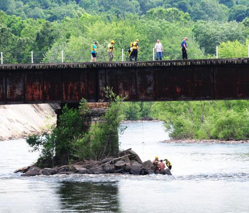 LARRY NEFF/SPECIAL TO THE TIMES NEWS Emergency rescues work proceed into the Lehigh River beneath the Lehighton trestle during drowning incident, which occurred at about 3:30 p.m., Friday. Wanda D. Wentz, 49, of Lehighton, died; and her grandson,…