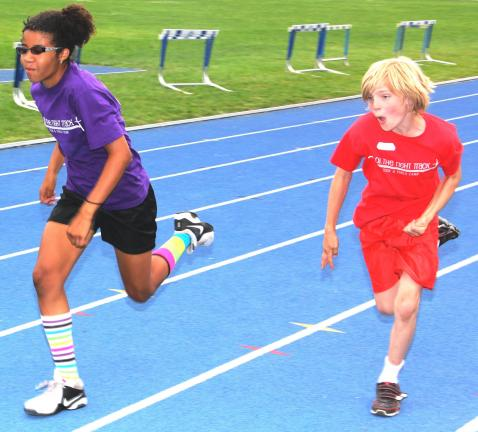 ANDREW LEIBENGUTH/TIMES NEWS Members and volunteers of the Christ Evangelical Lutheran Church in Lehighton wrapped up their co-ed track and field camp on Friday at the Tamaqua Area Sports Stadium. The event, which was for kids aged 5 through 13,…