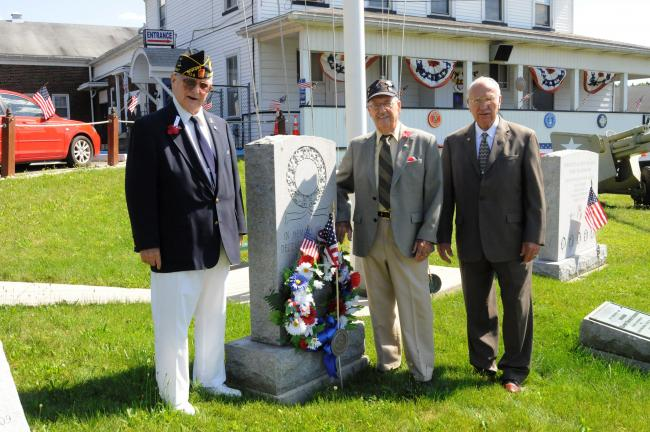 RON GOWER/TIMES NEWS Standing next to Korean War monument at the Lehighton American Legion Post are officers of the Korean Last Man's Club, l-r, John R. Williams, vice president; Robert D. Berger Jr., president; and Leroy Goldberg, secretary…