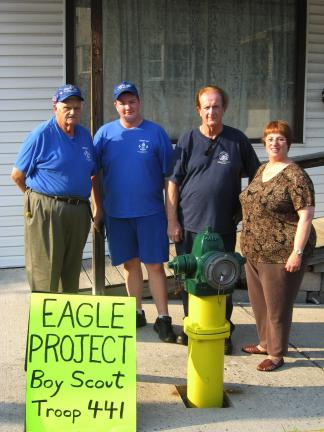 @$:Standing behind a portion of the completed Eagle Scout project of Bruce Solomon Jr. is John Herbert, left, Scoutmaster of Troop 441; Scout Bruce Solomon Jr.; and his parents Bruce Solomon Sr. and Gail Solomon.