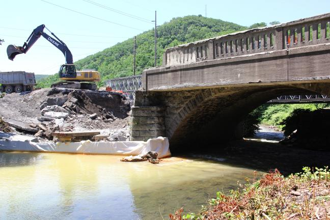 ANDREW LEIBENGUTH/TIMES NEWS Contractors are almost half way through the demolition of the old SR309 bridge.