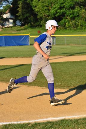 Mike Feifel/TIMES NEWS Danny Keer rounds the bases after he hit a homerun vs. White Haven on Wednesday night. FT beat WH 23-2.