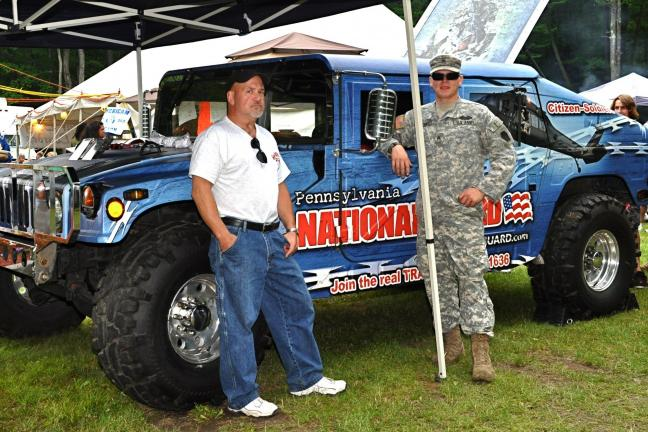 VICTOR IZZO/SPECIAL TO THE TIMES NEWS President of the Weatherly Hill Climb Association Joe Cyburt stands with PA National Guardsman Sgt. E5 Daniel Krivenko Alpha Troop 2nd 104th Cavalry out of Hazleton, PA alongside of the National Guard Hum-Vee…
