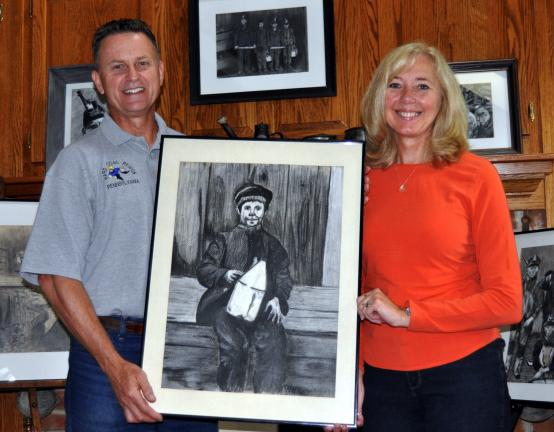DONALD R. SERFASS/TIMES NEWS Retired art teacher and football coach Joe Evanousky, Barnesville, has spent a lifetime illustrating the culture of the coal regions, a passion he shares with wife Rochelle, artist, educator and former swim coach.