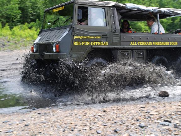 Al Zagofsky/special to the times news The six-wheel Pinzgauer has no trouble plowing through up to 30 inches of water or mud.