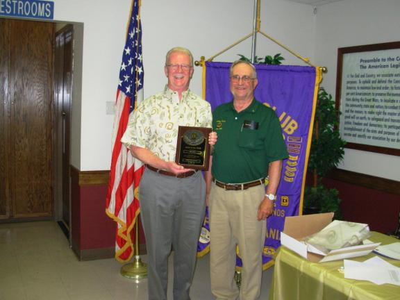 ADELE R. ARGOT/SPECIAL TO THE TIMES NEWS Lion of the Year David Rowan, left, holds the plaque presented him by Western Pocono Lions Club president, Charles Rush. Rowan has been a Lion since 2002.
