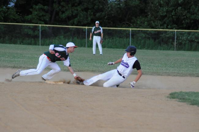 ron gower/times news Vince Mele of the Franklin Shockers is tagged trying to steal second base by the Franklin Hurricanes second baseman Mike Cataldo.
