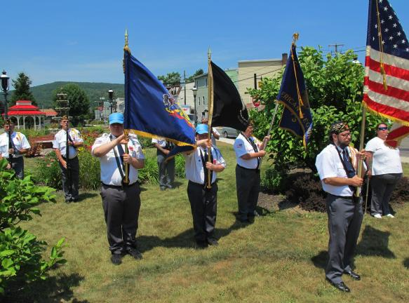 ANDREW LEIBENGUTH/TIMES NEWS Members of the Tamaqua American Legion color guard proudly display colors during the ceremony.