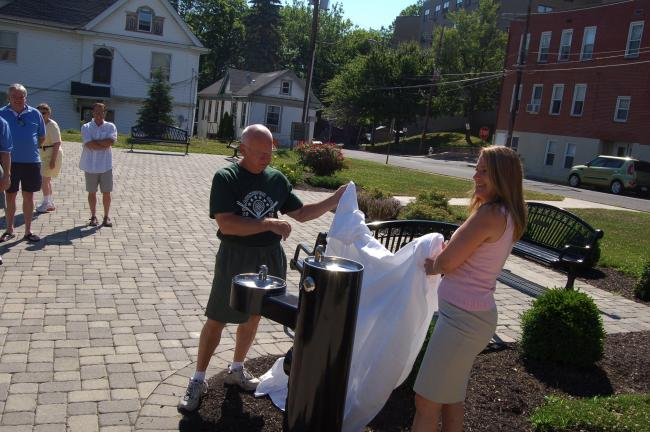 Slatington Borough Mayor Walter Niedermeyer, and Ellie Passman, vice president or Regional Chambers for the Greater Lehigh Valley Chamber of Commerce, on Tuesday proudly unveil the new drinking fountain that now adorns Slatington's Memorial Park.