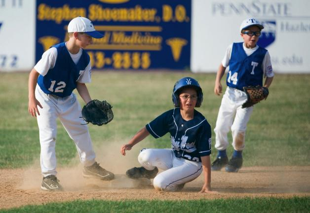 BOB FORD/TIMES NEWS Valley West's Chris Lateff slides into second base safely as Tamaqua's Adam Rex (left) and Tyler Steigerwalt (right) cover. Valley West picked up its second win to win the best-of-three series.