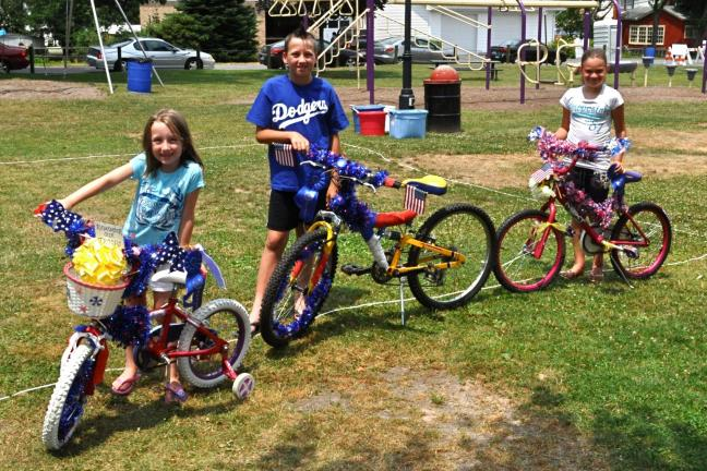 VICTOR IZZO/SPECIAL TO THE TIMES NEWS The winners of the bicycle decorating contest at Jim Thorpe's annual 4th of July Stay-At-Home Festival were, left to right : Jenna Goff, Nick Goff, and Mikara Miller.