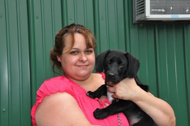 AMY MILLER/TIMES NEWS Debbie Craver, the new Carbon County animal warden, holds Lennon, a 6-week-old black Labrador mix that is up for adoption at the Carbon County Animal Shelter in Nesquehoning. Craver said she believes that to make the shelter…