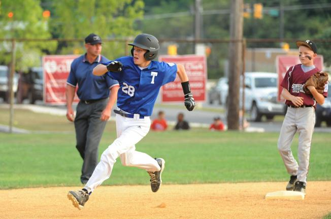 nancy scholz/times news Tamaqua's Josh Inama (28) rounds second base and heads for third during the Section 6 Little League All-Star game Monday night against Stroudsburg.