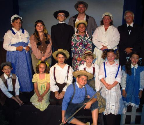 "ANDREW LEIBENGUTH/TIMES NEWS The cast consists of Ron Calarco, West Penn, as ""Mark Twain""; Jack Ligenza, 11, Slatington, as ""Tom Sawyer""; Jessica Wensus, 13, St Clair, as ""Huck Finn""; Collin Starr, 13, Middleport, as ""Joe Harper'; Maizy Troxell, 12,…"