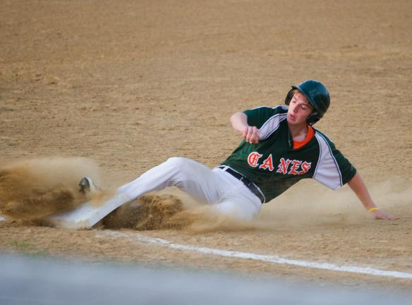 BOB FORD/TIMES NEWS Franklin Hurricanes' Bryce Micciche slides into third base safely during Tuesday night's Keystone Senior Babe Ruth League win over the Pocono Outlaws.