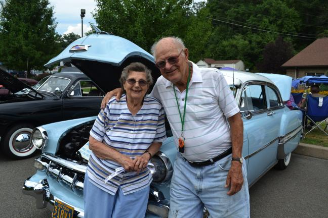 SHERI RYAN/SPECIAL TO THE TIMES NEWS Enjoying the day and each other's company are from left, Florence and Eugene Tokosh who will celebrate their 68th anniversary this weekend by renewing their vows. They are standing in front of a 1954 Chevy owned…