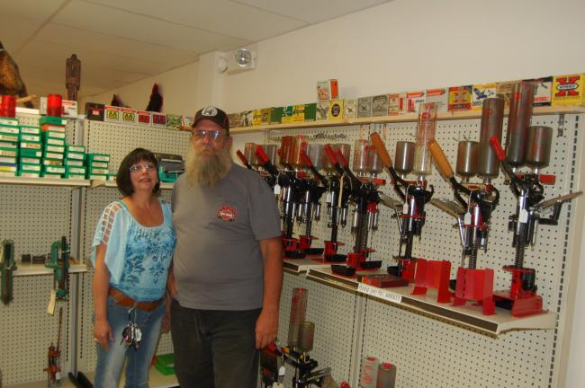 TERRY AHNER/TIMES NEWS Russ Unangst, owner, and his companion, Josephine Cacace, stand inside the recently-opened Hillbilly Shootin' Irons, located at 202 Delaware Avenue, Suite 2, in Palmerton.