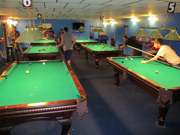 ANDREW LEIBENGUTH/TIMES NEWS Pictured are six of the eight billiard tables available for customers to use. The business also offers arcade games, an air hockey game, a jukebox and food.