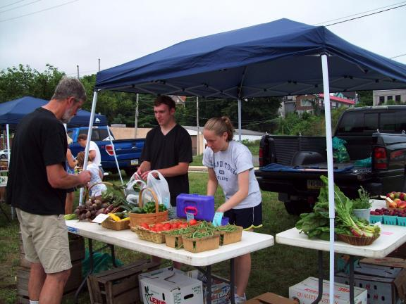 Gail Maholick/TIMES NEWS Mike Curtis and Katie Ward sell produce at the Lehighton Farmers' Market, which recently opened along the Stanley Hoffman Boulevard (bypass) in Lehighton. They represent Lyle's Produce in Brodheadsville.