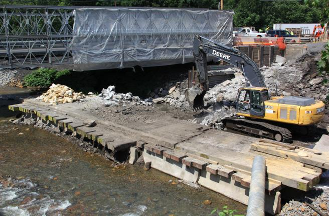 ANDREW LEIBENGUTH/TIMES NEWS Workers have built diversion waterways to keep running water of the Little Schuylkill River out of the work area.