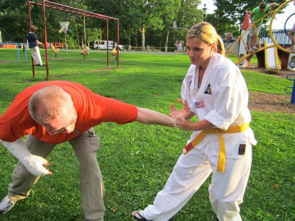 Mark Janner, of Janner's Martial Arts, demonstrates with Mel Augustine some self defense skills. Janner's Martial Arts was at NNO to discuss their program and demonstrate basic self defense skills if anyone was interested. Janner suggested as a big…