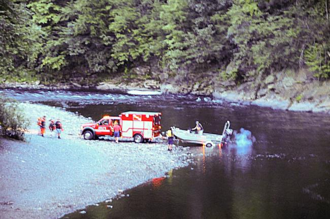 A boat and dive team of the Whitehall Fire Department prepare to enter the Lehigh River to aid in the recovery of Monday evening's drowning victim, Noah Krynock, at the Lehigh River.