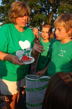 Gail Maholick/TIMES NEWS Shannon Frycklund and Cole Frycklund release butterflies at the Mahoning Valley 4-H Round Up.
