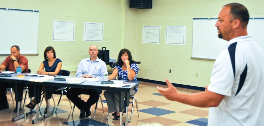 DONALD R. SERFASS/TIMES NEWS Tamaqua Area School District Athletic Director Mike Hromyak explains the steps taken by the newly formed Tamaqua Area Booster Board at Tuesday's council workshop. Taking in the details are, from left, Raymond Kinder,…
