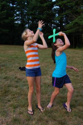 Andie Gay and Maddie Killen practice throwing foam boomerangs at Carbon County Conservation Camp.