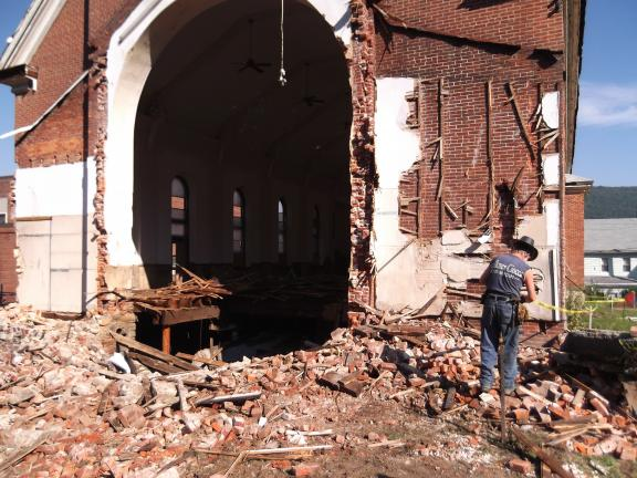 A hole is shown in back of the Sacred Heart Church in Nesquehoning which has been demolished. This is the area of the sacristy of the church after work began.