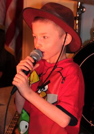 "ANDREW LEIBENGUTH/TIMES NEWS Adam Bachert, 7, sings ""School's Out"" by Alice Cooper."